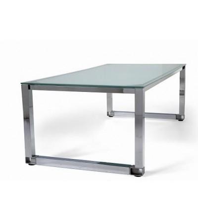 Detalle de mesa de oficina de cristal patas cromadas
